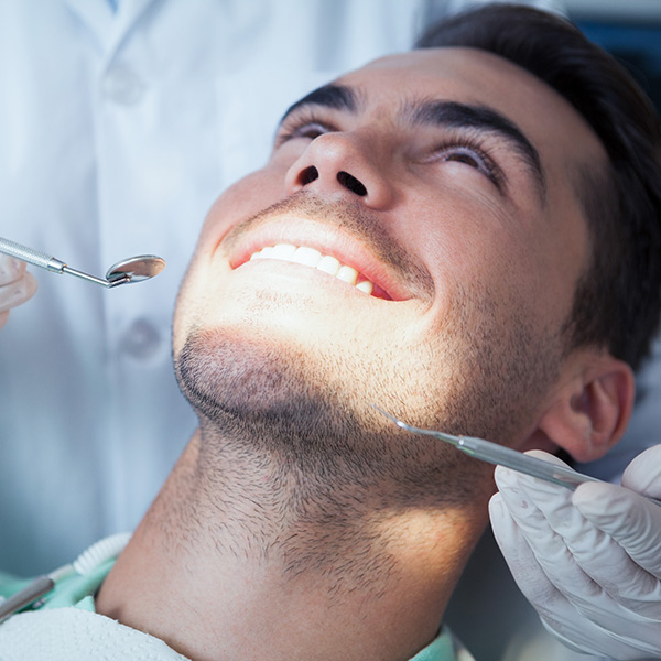 A Man Receiving A Dental Exam
