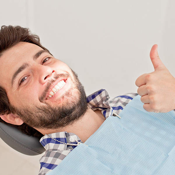 Man Smiling After A Successful Tooth Extraction